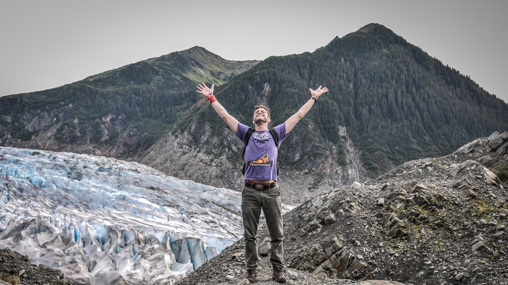 Man-Celebrating-Freedome-In-nature-With-Glacier-11